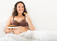 Woman eating sweet chocolate chip cookies Royalty Free Stock Image