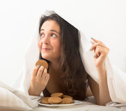 Woman eating sweet chocolate chip cookies Stock Image