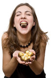 Woman eating sweets Stock Photos
