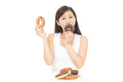 Woman eating sweets. Happy young woman eating sweets Royalty Free Stock Photo