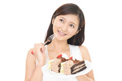Woman eating sweets. Happy young woman eating sweets Stock Images