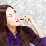 Woman eating sweets at winter Royalty Free Stock Photography