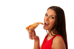 Woman eating tasty piece of pizza. Unhealthy fast food meal. Stock Photography