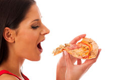 Woman eating tasty piece of pizza. Unhealthy fast food meal. Stock Photo