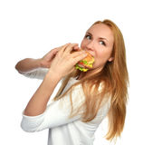 Woman eating tasty unhealthy burger sandwich hamburger in hands Royalty Free Stock Photos