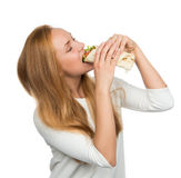 Woman eating tasty unhealthy twister sandwich in hands hungry Royalty Free Stock Photo
