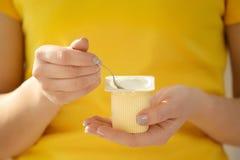 Woman eating tasty yogurt. Closeup Royalty Free Stock Photography