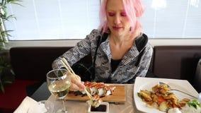 Woman eating Temaki Cone stock footage