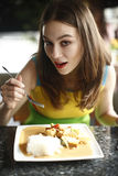 Woman eating thai food. royalty free stock photos