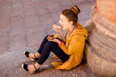 Woman eating tiramisu outdoors Stock Image