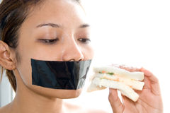 Woman eating toast Stock Images