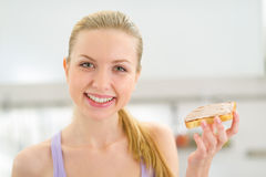 Woman eating toast with chocolate cream Stock Image