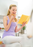 Woman eating toast with chocolate cream Royalty Free Stock Photography