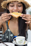 Woman eating toast Royalty Free Stock Photos