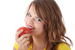 Woman eating tomato Royalty Free Stock Photos