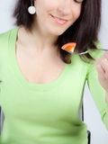 Woman eating tomato Royalty Free Stock Images