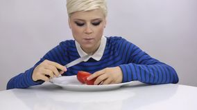 Woman is eating Tomato stock video footage