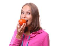 Woman eating a tomato, isolated Royalty Free Stock Photo