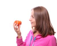 Woman eating a tomato, isolated Stock Images