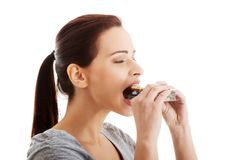 Woman eating too many pills Royalty Free Stock Image