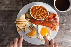 Woman eating a traditional English breakfast.Top view Stock Photos