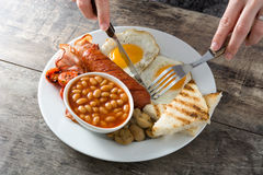 Woman eating a traditional English breakfast.Top view Stock Photography
