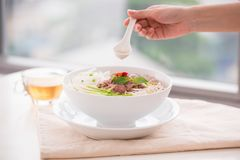 Woman eating traditional Vietnamese Pho noodle using chopsticks. Woman eating traditional Vietnamese Pho noodle using chopsticks Royalty Free Stock Photo