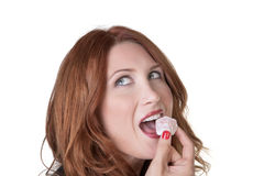 Woman eating turkish delight Stock Images