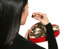 Woman Eating Valentines Chocolate Stock Photo