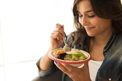 Woman eating a vegan bowl. Of superfoods Royalty Free Stock Photos