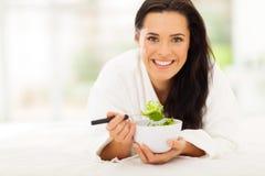 Woman eating vegetable Stock Photos