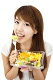 Woman eating vegetable and salad Stock Photo