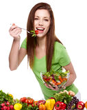 Woman eating vegetable salad Royalty Free Stock Images