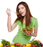 Woman eating vegetable salad Royalty Free Stock Image