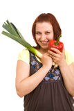 Woman eating vegetables Stock Images