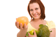 Woman Eating Vegetables Royalty Free Stock Images