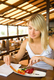 Woman eating vegetarian food Royalty Free Stock Images