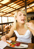 Woman eating vegetarian food Royalty Free Stock Photography
