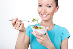 Woman eating vegetarian salad Stock Photography