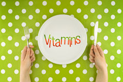 Woman eating vitamins, top view Stock Image