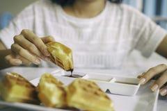 Woman eating waffle Stock Photos