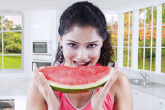Woman eating watermelon on autumn background Royalty Free Stock Photo