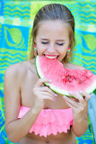 Woman eating watermelon with her eyes closed Stock Photos