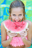 Woman eating watermelon Stock Photo