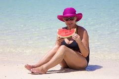Woman eating watermelon Stock Images