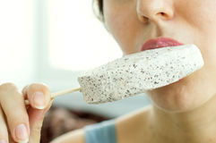 Woman eating white ice cream Stock Images