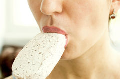 Woman eating white ice cream Royalty Free Stock Photography