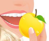 Woman eating yellow apple Stock Photo