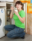 Woman eating  yoghurt from refrigerator Royalty Free Stock Photos