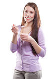 Woman eating yogurt Stock Image
